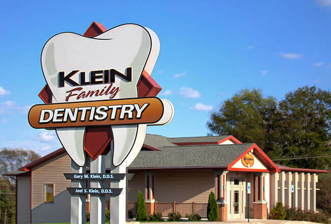Outside view of Klein Family Dentistry and street sign