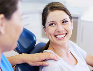 Laughing patient in dental chair