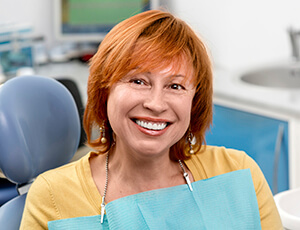 Older female patient smiling in dental chair