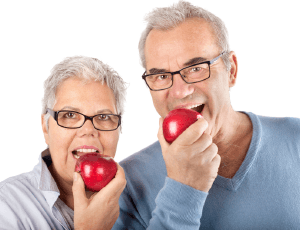 Older man and woman eating red applesd