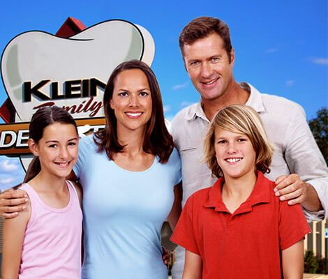 Happy family in front of Klein Family Dentistry